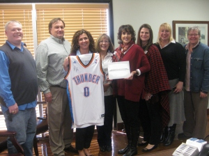 Celebrating the winners of the recent raffle to support the United Way of Logan County are: (L-R) Price Purvis, United Way; Companion Health Staff, Jeff Chappell, Tandie Hastings, Donna Bennett, Laura Meyer, Whitney Moss, Shannon Hilbern, and Mary Coffin, Guthrie Chamber President.