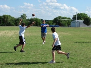 Asst. Coach Ric Meshew goes through some drills with campers at the GHS practice field. Photo By Chris Evans