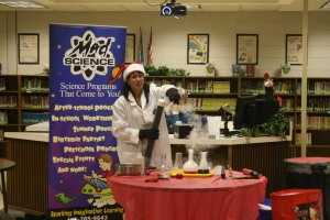 The mad scientist demonstrates a project in front of students. Photo By Chris Evans