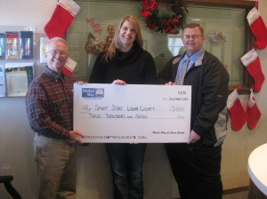 (L to R) Steve Gentling, President United Way; Shayla Simpson, Smart Start Coordinator; and Chuck Hayes, United Way during a presentation of a grant to Smart Start to support children programs throughout Logan County.