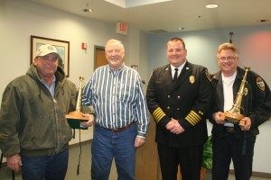 Fire Chief Eric Harlow and Mayor Chuck Burtcher recognized Rodney Davison (left) and Charles Stowe (right) for their 25 years of service and retirement. Photo By Chris Evans