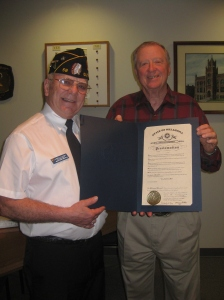 Albert Hawkes (L), American Legion Post 58 Commander, presents Guthrie Mayor, Chuck Burtcher (R), with the  Governor's 2013 Proclamation recognizing Guthrie as the official '89er Celebration city of Oklahoma.