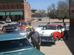 Guthrie Mayor Chuck Burtcher, center, stands along with some of his fellow classic car friends in Guthrie. They will be participating in the Geezers and Gassers Car Show and Poker Walk in downtown Guthrie on Friday, April 19 from 6 to 9 p.m.