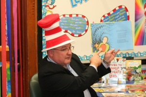 Supt. Mike Simpson took time out to read to Mrs. Jamie Alexander's second grade students celebrated Dr. Suess' birthday. Photo By Chris Evans