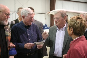 Senator Jim Inhofe talks with Kay Wade inside a hangar at the Guthrie-Edmond Regional Airport.