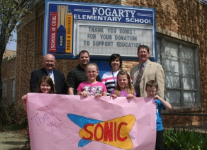 Dr. Mike Simpson (left), Sonic Manager Brian Billings, Fogarty Principal Karen Watkins and Asst. Supt. Dennis Schulz stand with students Madsen Hasler, Skylar Wright, Mallory Downs and Kolten Freeman.
