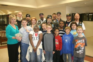 Members of the Territorial Riders join Laura Benham's class for the generous donation.