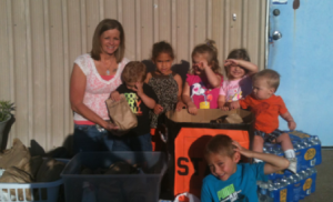 The crew from Freckles N' Grins make their donations to EMI for the victims in Carney.