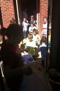 Students at Central Elementary help fill the bus up with donations for those affected by the tornadoes.