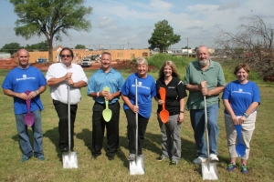 Phillip Carothers, Jeff Chappell, Barry Anderson, Sarah Anderson, Dawn Hacker, Mayor Mark Spradlin and Amy Carothers help break ground on the new building.