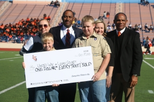 """Langston presents """"Homecoming Check"""" to United Way of Logan County.  Pictured from Left to Right: Ashleigh Sorrell Rose, United Way; Dylan Jones; Dr. Kent Smith, Langston University President; Cody Jones; Jessica Eaves, United Way; and Mike Garrett; Langston University Athletic Director"""