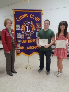 Lion Sylvia Ochs (L) presents Students of the Month, Andrew Toney (C) and Elizabeth Shafer (R) to the Guthrie Noon Lions Club