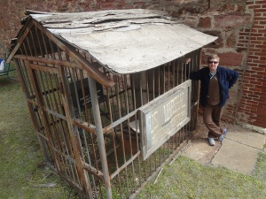 "Stacey Frazier, Chair of the Jail House Rocks Committee, inspects ""THE JAIL"" in advance of '89er Celebration Week."