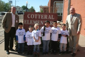 Mercy's Josh Tucker (left) and Dr. Mike Simpson helped pass out the first shirts of the day to Cotteral students (L-R) Aiden Charria, Lexy Beckham, Aubrey Keating, Natalie Torres, Lisandro Orellna and Wayne Long.