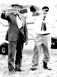 "Lester Lurk (aka Will Rogers) and Joe Bacon (aka Wiley Post) will be joining other dignitaries at the '89er Celebration in Guthrie America. ""Will and Wiley"" are shown here at the Claremore Airport ""Fly in""  two years ago."