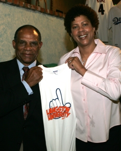 Langston Athletic Director Mike Garrett and Lion's head coach Cheryl Miller.