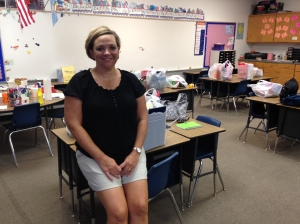Julie Wiss, second grade teacher at Mulhall-Orlando Schools, sits in her classroom amidst school supplies donated and delivered by the Logan County United Way Board.