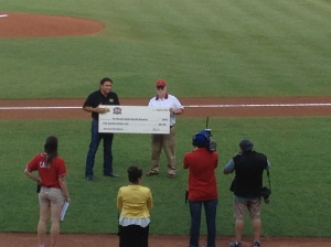Richard Hendricks with the Territorial Sports Museum accepts a $500 donation from Hertz.