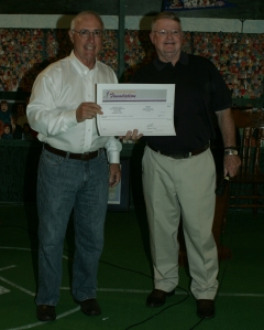 CREC board member from Guthrie Len Tontz at left displays the oversized check conveying a grant to TCSM executive director Richard Hendricks