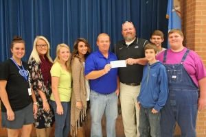 Seth Robbins (center) donates a check to teachers Scott Mick and Jordan Hodge for GHS students to attend the wildlife expo.