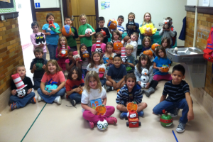 Students show off their pumpkins and await the big donut party on Friday.