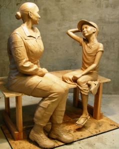 The seated sculpture of mother and child in clay representing the sacrifice servicewomen make being away from their families shows how a Women's Veteran Monument will look when it is dedicated Nov. 11 at Patriot Park in Del City, Okla. Photo by Joel Randell.