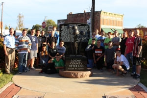 "Major Mick Fredrickson, (L), faculty instructor, leads Junior ROTC students from Guthrie High School on a mission of ""clean up, fix up and paint up"" the Veterans Memorial at Honor Park in Guthrie."