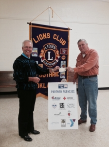 Guthrie Lions Club Vice President, Richard Ireton  (R) presents a check for $2,000 to Steve Gentling (L), President of United Way of Logan County.