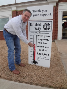 "Ed Stanton, Crescent City Manager, updates the United Way of Logan County Thermometer and celebrates Crescent city employees being recognized as members of the ""100% Club"""