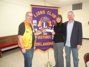 Lions Club President John Wood(L) presents a check for $500 to Terri Kennedy(C)  and Bill Kennedy(R) of the Guthrie Job Corps