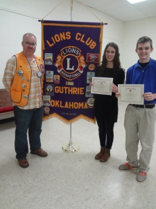"""Lion President, John Wood (L) presents recognitions of """"Student of the Month"""" to Kaylea Hopfer (C) and Tyler Porter (R) for their outstanding achievements"""