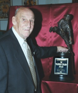 Warren Spahn said he was proud to present this first trophy to Randy Johnson in 1999. Photo by Darl DeVault