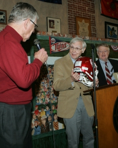 """A former Robertson football player, Chuck Bowman (at left), presented Edgar L. Frost with an OU football helmet autographed by many of Robertson's former """"Peaheads"""", Robertson's famous label for athletes in need of """"supervision"""" while TCSM director Richard Hendricks watches at right. (Photo by Darl DeVault)"""