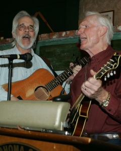 Legendary fiddle player Byron Berline (at right), one of Robertson's former football players who mostly competed in track and field, sang portions of the national anthem while accompanying on his mandolin with Jim Fish on acoustic guitar. (Photo by Darl DeVault)