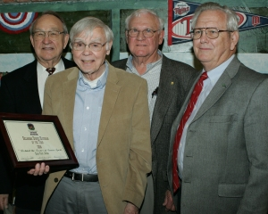 2014 Oklahoma Sports Historian of the Year honoree Edgar L. Frost (with plaque) stands with former OU athletes Leon Cross (from left), Dale Sullivan and Ed Corr who asked him to write his book: Port Robertson: Behind the Scenes of Sooner Sports. (Photo by Darl DeVault)