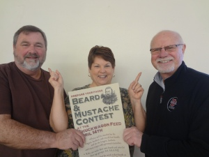 Tami Boxley, center, examines the beards of prospective '89er contestants, Dave Wolek (L) and Jerry Ball (R).