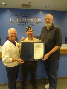 89er Celebration Chairman, Steve Gentling (L) and American Legion LeBron Post 58 Commander, Jerry Webster (C) present the Governor's Proclamation to Guthrie Mayor Mark Spradlin (R) recognizing Guthrie as the official '89er Celebration City.