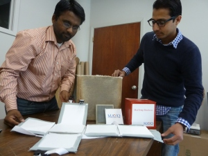 Saravan Kumar, left, and Shoaib Shaikh, right, showcase various components of the cold chain shipping containers that their company MaxQ produces. The company is housed in the Center for Business Development at Meridian Technology Center and will take part in an open house on April 7. The event is open to the public.